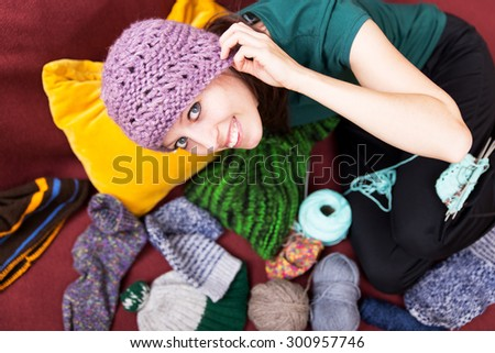 pretty young woman with a wool hat - stock photo
