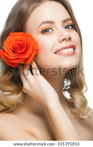 Pretty young woman with beautiful fresh make-up and perfect healthy skin with rose - stock photo