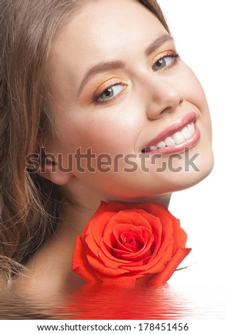 Pretty young woman with beautiful makeup and perfect healthy skin with rose in water - stock photo