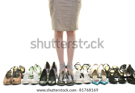 pretty young woman with buying shoes addiction, isolated on white background in studio - stock photo