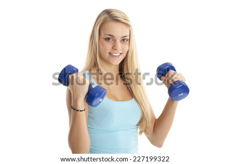 Pretty young woman with dumbbells.