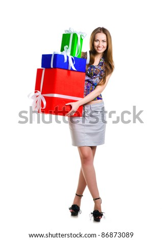 Pretty young woman with gifts on white background. Studio shot - stock photo