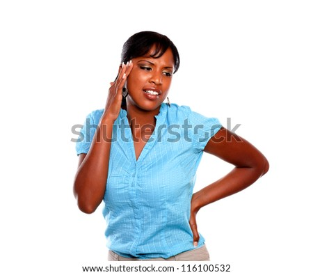 Pretty young woman with headache on blue shirt against white background - stock photo