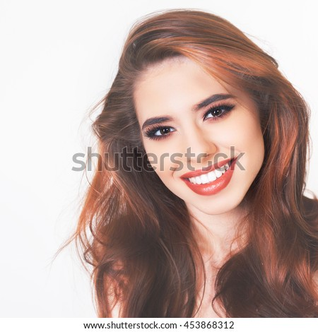 Pretty young woman with healthy perfect hair and white smile. Crowns tooth, teeth. Hair. Beauty. Hairstyle. Shampoo and natural herbal balsam. - stock photo