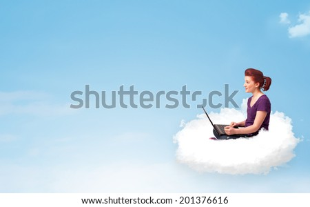 Pretty young woman with laptop sitting on cloud with empty space - stock photo