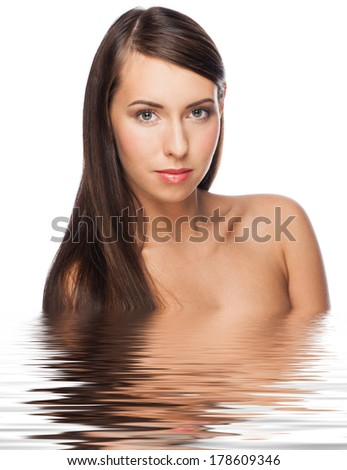 Pretty young woman with long straight brown hair and healthy skin in water. Beauty treatment concept