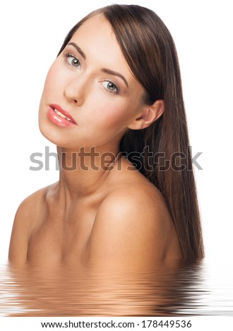 Pretty young woman with long straight brown hair and healthy skin in water, isolated on white background