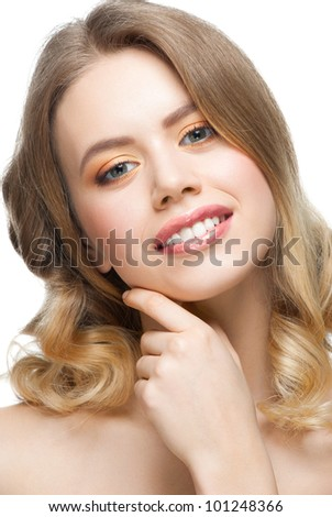 Pretty young woman with perfect healthy skin touching her face - stock photo