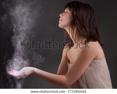 Pretty Young Woman With Powder Floating in the Air - stock photo