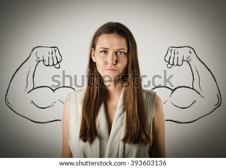 Pretty young woman with sketched strong and muscled arms.  - stock photo