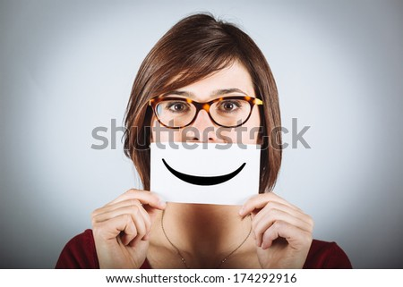 Pretty Young Woman with Smiley Emoticon - stock photo