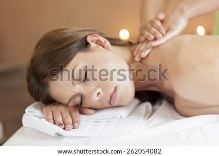 Pretty young women having a massage - stock photo