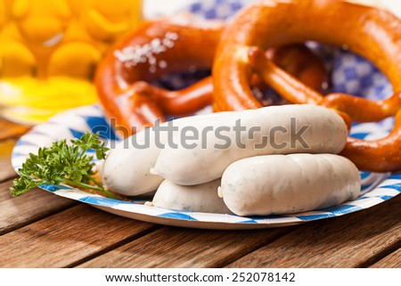 pretzel, white sausages and beer - stock photo