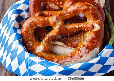 Pretzels in basket on blue napkin - stock photo