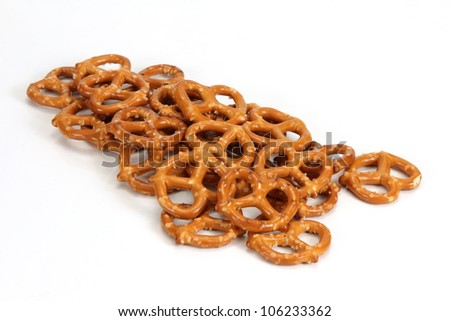 Pretzels lay on a tabletop on white table - stock photo