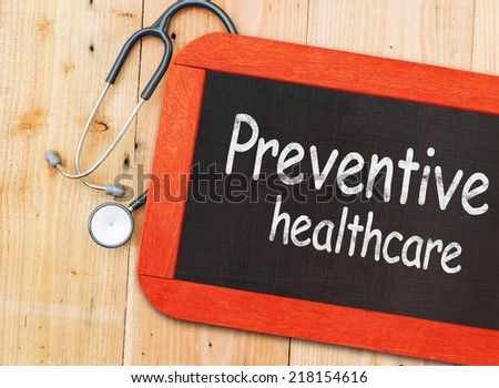 Preventive healthcare written in chalkboard. - stock photo