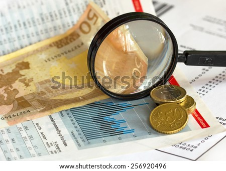 Price index graph magnifying glass and euro currency - stock photo
