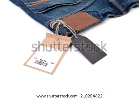price tag with barcode on  jeans textured - stock photo