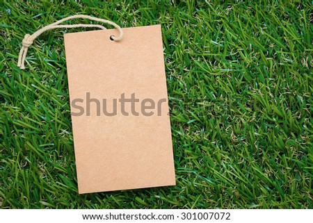 Price tags, labels on green grass background - stock photo
