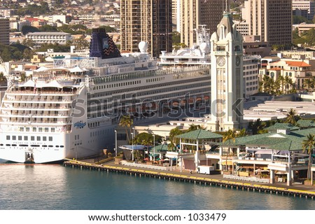 Pride Of America cruise ship docked in Honolulu Harbor at the Aloha Tower Marketplace pier. - stock photo