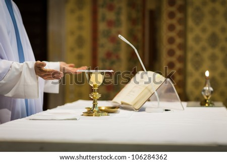 Priest during a wedding ceremony/nuptial mass - stock photo