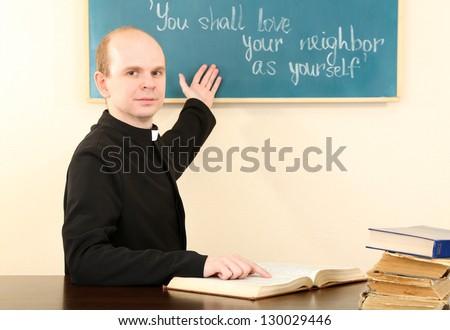 Priest in Sunday school - stock photo