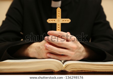 Priest reading from the holy bible, close up - stock photo
