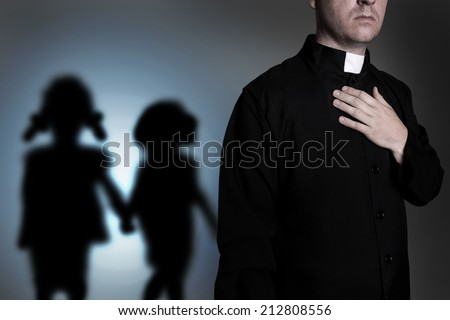 Priest with shadow of children - stock photo