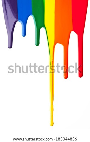 Primary colored and secondary colored paint drip on a white surface. - stock photo