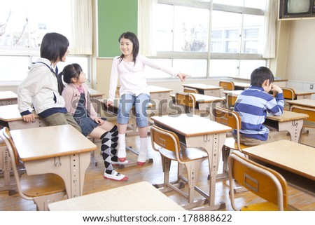 Primary Japanese boy suffering bullying - stock photo