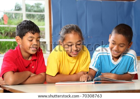 Primary school class reading and learning together - stock photo