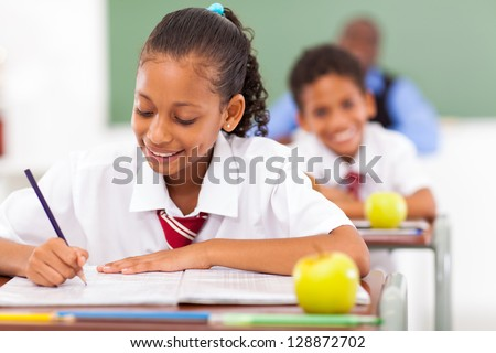 primary school students in classroom - stock photo
