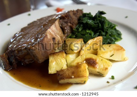 Prime Rib and Spinach and roasted potatoes - stock photo
