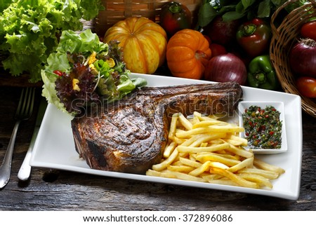 Prime rib with fries and salad - stock photo
