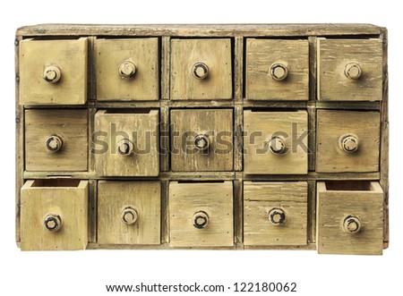 primitive wooden apothecary or catalog cabinet with partially open drawers - storage or sorting concept - stock photo