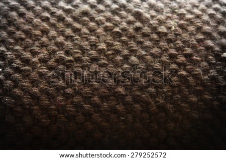 Primitive wool knit or weaving close up. Shallow depth of field. - stock photo