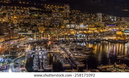 Principality of Monaco, France, on October 16, 2012. A night view of the port and residential areas on a slope of mountains - stock photo