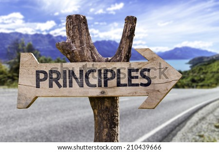 Principles wooden sign with a highway on background - stock photo