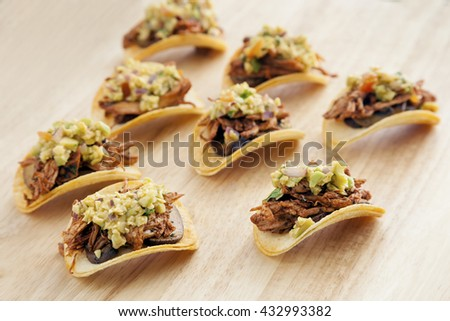 Pringles chips with spicy shredded chicken and vegetables, Mexican style of finger food. - stock photo