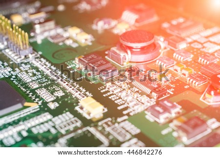 Printed Circuit board from a computer in black with green lines - stock photo