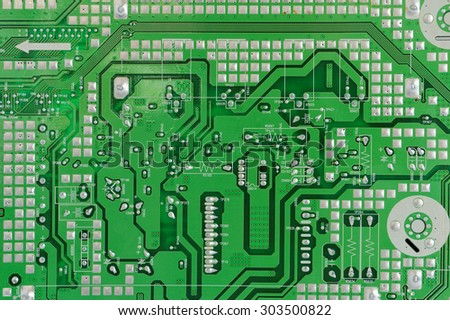 Printed circuit green  electronic  board background. Mass production.  Only standard position of components.