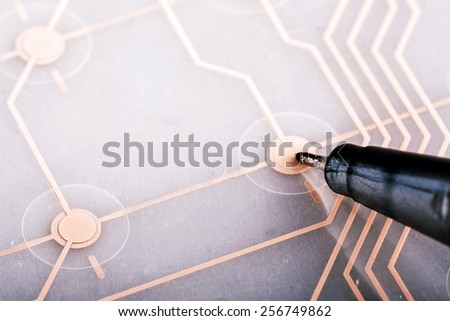 printed circuit - inside of keyboard, computer part with pen - stock photo