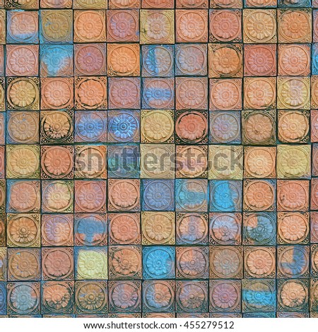 printed clay ceramic brick wall with patterns and scratched - stock photo