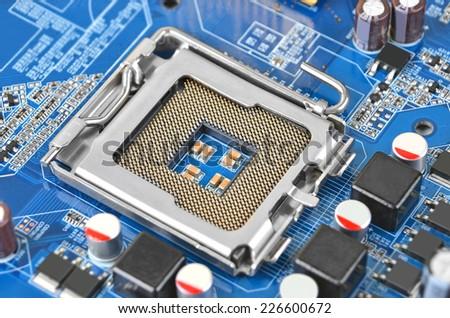 Printed computer motherboard, CPU socket, close up, DOF - stock photo