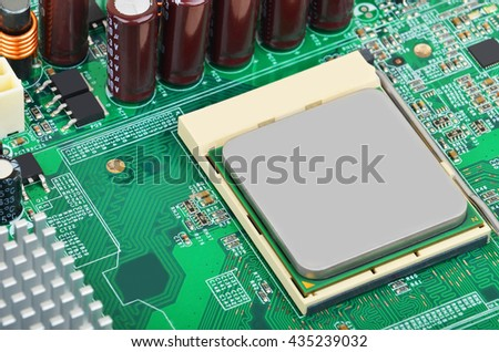 Printed computer motherboard, CPU socket, close up, DOF - stock photo