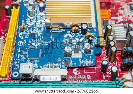 Printed computer motherboard. Electronic computer device - stock photo