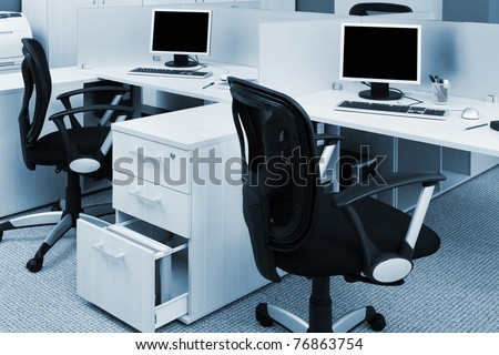 printer and computers in a modern office - stock photo