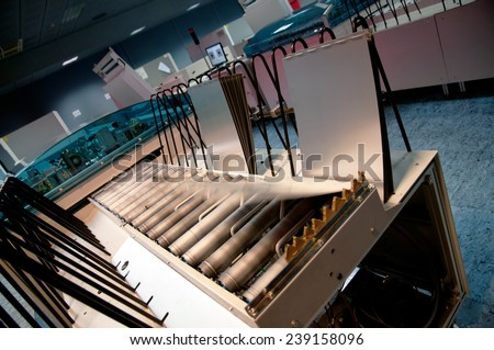 Printing Plant - Computer to plate department. CTP is an imaging technology used in printing processes. An image created in a Desktop Publishing application is output directly to a printing plate. - stock photo