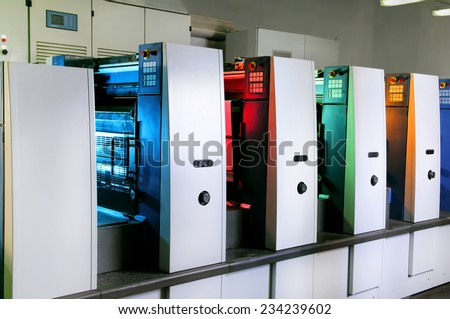 Printing presses at work in the printing - stock photo