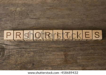 priorities text on wooden cubes - stock photo